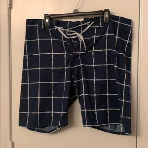 Blue and white patterned swim shorts